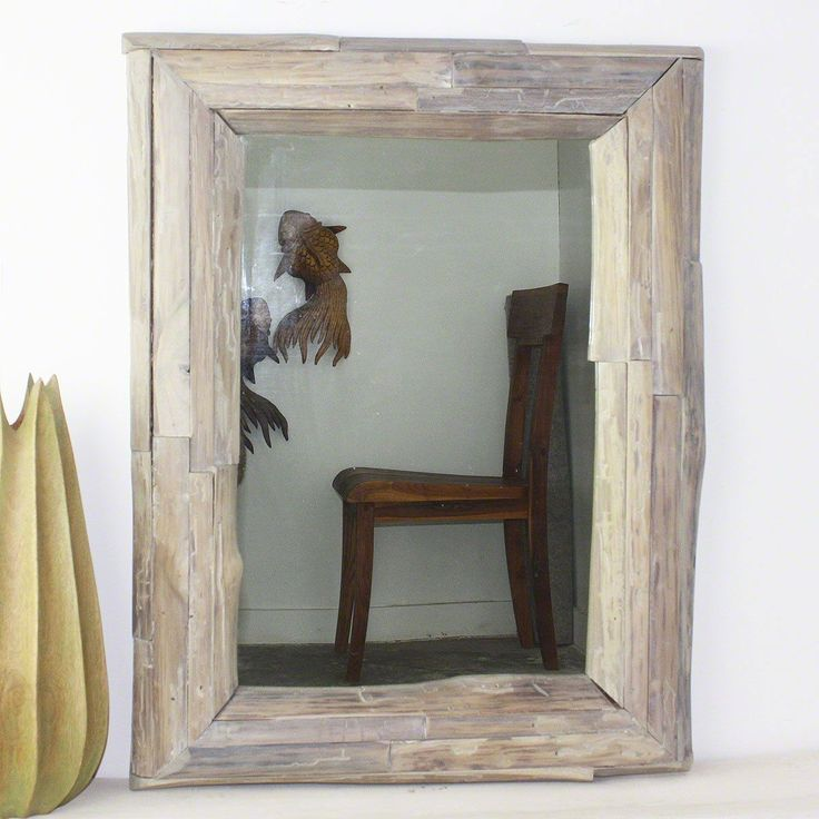 Decorate your home with this stunning handmade framed mirror from Thailand. Framed in farmed teak branch wood, this mirror is the perfect accent piece for any room in your home.