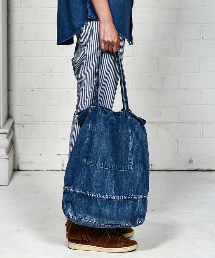railroad striped pants with denim blue shirt and shopper bag