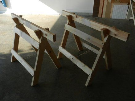 Folding Sawhorses, these made up and a sheet of plywood of whatever dimensions you need would make a Hell of a work table in camp.