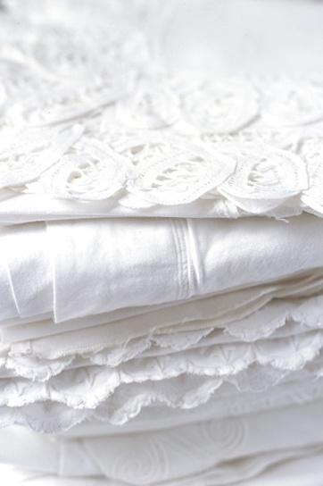 Pile of pretty white fabrics