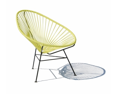 The Acapulco chair by OK Design in yellow, suitable for outdoor use. Available at Tempo Berlin http://www.tempoberlin.com