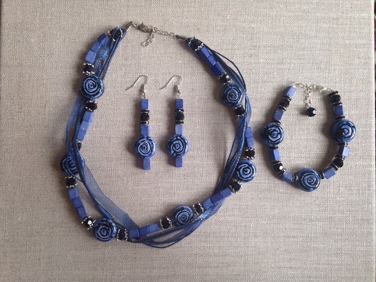 A personal favorite from my Etsy shop https://www.etsy.com/listing/250724701/blueish-gray-beaded-necklace-with