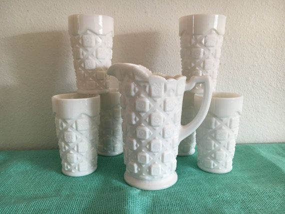 Vintage Westmoreland Old Quilt Pattern milk glass set of 7. 6 water tumblers 5 1/4 inches tall and 1 pitcher 7 1/2 inches tall. All in great condition, no chips or cracks.