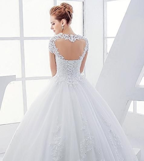 BB1405 sweetheart neckline with small capped sleeves and corset back. Intricate lace and beadwork on bodice and skirt. Beautiful keyhole back