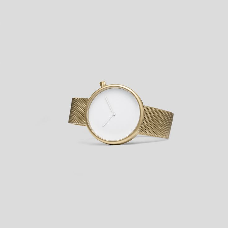 MATTE, GOLDEN STEEL ON A GOLDEN, MILANESE STEEL BRACELET FROM ARISTO VOLLMER.   Say hi to the new, luxury-tinted Bulbul watch: Ore 08.    Ore 08 is a striking update on the circular, minimalist Ore design with a touch of golden, old-world charm. Featuring matte, golden steel on a German-made, Milanese mesh band from Pforzheim-based manufacturer, Aristo-Vollmer, the materials make a subtly flamboyant contrast to the sharp, minimal aesthetic, making this a remarkable eighth addition to the Ore
