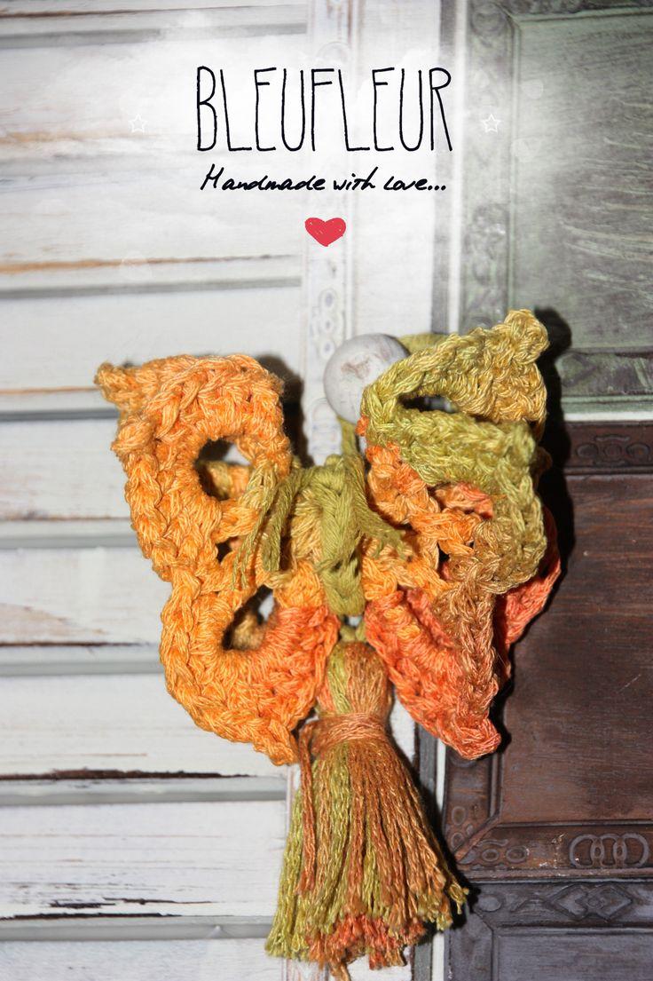 Mariposa realizada a crochet con algodón bicolor