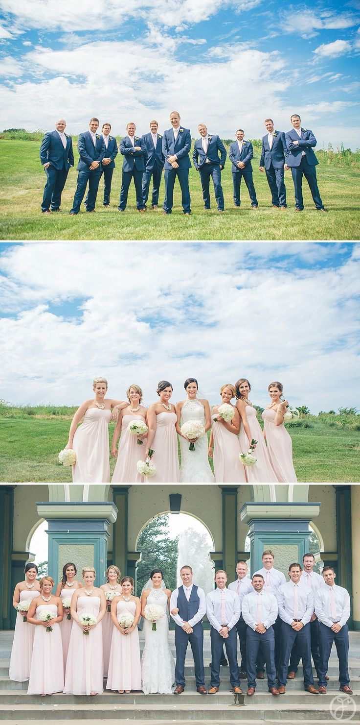 groomsmen in navy blue suits and pink ties, bridesmaids in blush pink dresses, w…