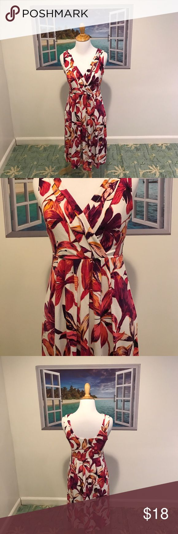 "Ann Taylor Tropical Dress Summer is coming! Let this Tropical Dress from Ann Taylor take u from a casual day to a night out, vacation etc! Dress it up or down! Size:XS. Used great condition. Bra friendly. Faux wrap front. Color is white with shades of pinks, purples, reds, black  & hints of like a burnt orange. Very soft! Approx 34"" length. Body 94% rayon 6% spandex. Lining 100% polyester. Machine wash. Dry flat. NO TRADES. Ann Taylor Dresses"