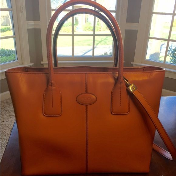 Classic TOD'S One of springs hottest colors- this authentic orange TOD'S bag will bring color and class to any outfit! Tod's Bags Totes