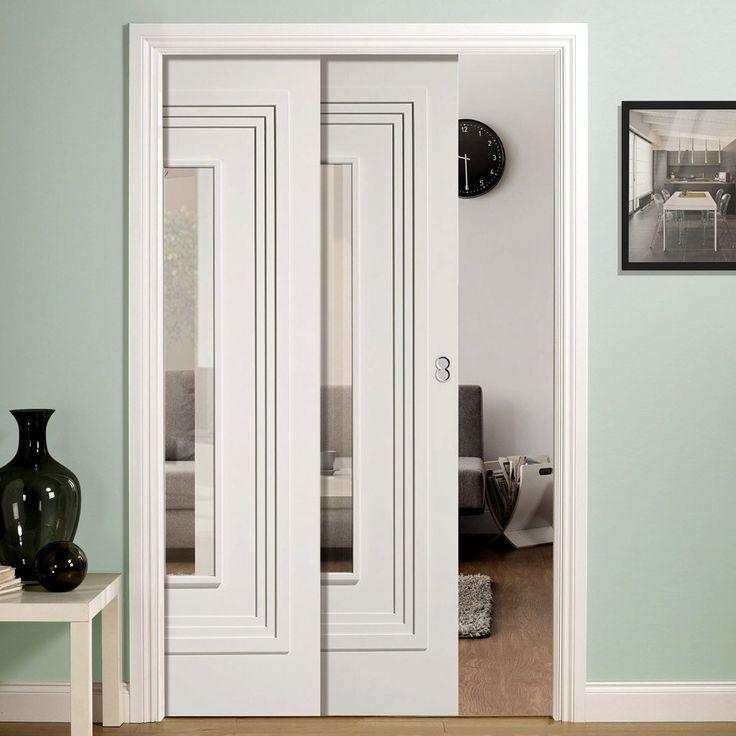 Twin Telescopic Pocket Atlanta White Primed Doors - Clear Glass.    #glazedpocketdoors #contemporarydoors #moderninteriordesign  #moderndoors  #hiddendoors