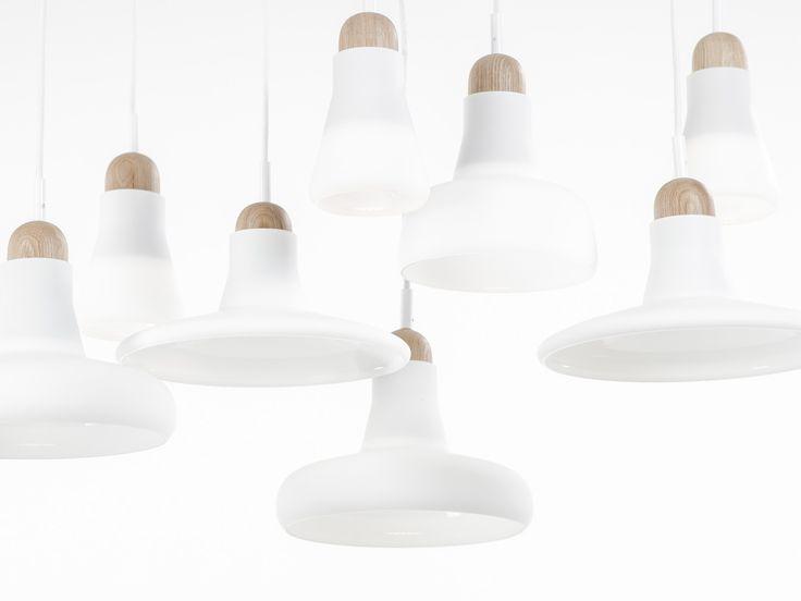 White interior - Brokis lights - White Shadows are hanging lights. The designer Lucie Koldova and Dan Yeffet