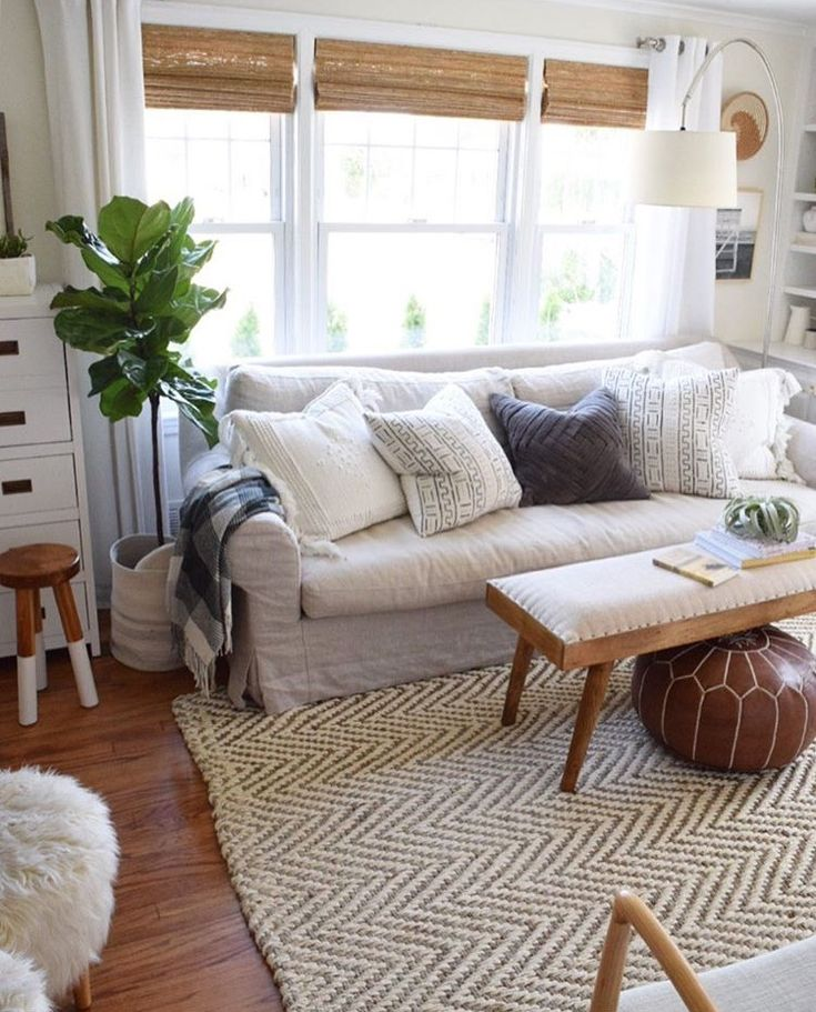 Living room with layers. Fiddle leaf fig, jute rug, natural couch, bamboo shades and more. #livingroom #layers