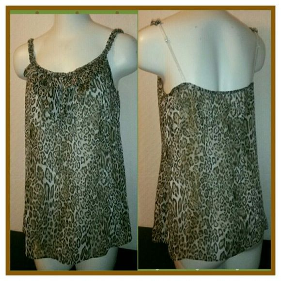 Attractive Animal Print Cami This New York & Company Cami is an attractive Animal Print with adjustable straps and is lined. Shell is 100% Polyester/Lining 100% Rayon. New York & Company Tops Camisoles