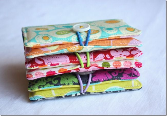 Business card holders (also fab for credit cards, or for gift card wrapping)
