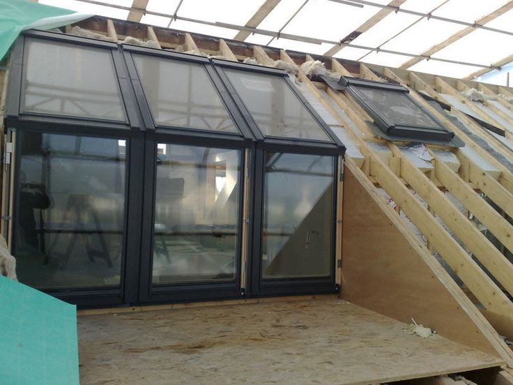 loft conversion with a balcony, that leads onto the news roof terrace