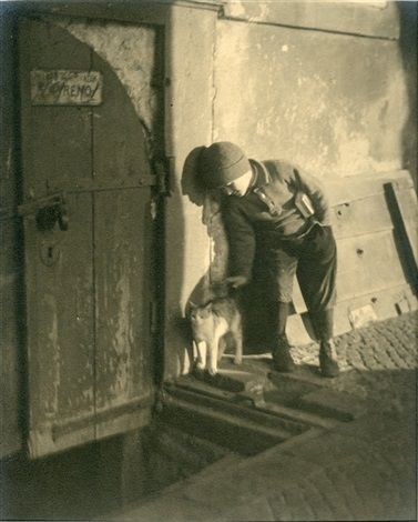 Boy with cat, 1920's - Photograph by Jaromir Funke (Czech, 1896–1945)