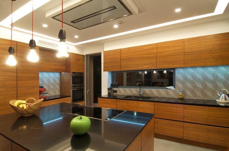 Kitchen made of American Walnut, with black quartz countertop, Cooker Hood Elica cloud nine  designed by AkPraxis for Adames Residence.