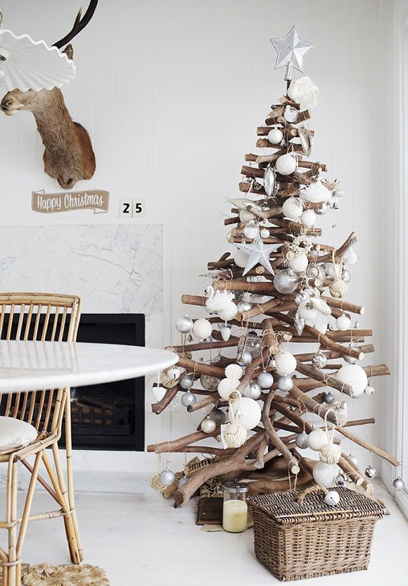 A minimalist rustic Christmas tree made from stacked branches!