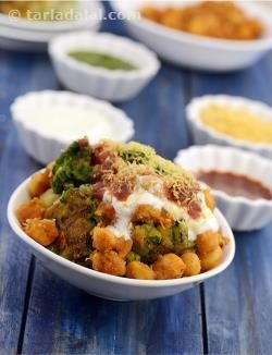A lip-smacking chaat that is loved all over India, and now globally too, the chole tikki chaat is most enjoyed at roadside stalls, but is definitely more satisfying when you make it at home for your family or for a party. Here, we show you how to make the potato and peas tikkis flavourfully perked up with nigella seeds, and the chole too. Also pay special attention to arranging this preparation, with curd, chutneys and fresh, crispy sev!