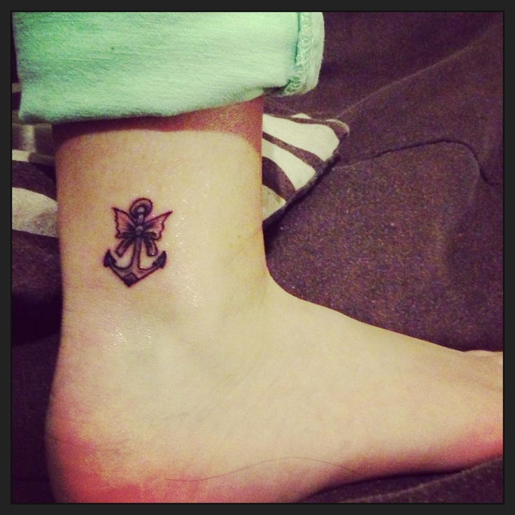 Pretty and girly anchor / bow tattoo