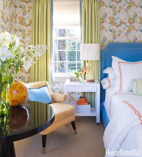 Gary McBournie's beach cottage has become a meeting place for friends and family every summer. He used soft oranges, blues, and greens to create this welcoming guest room. The custom Bob Collins & Sons upholstered walls reflect the light, joyful feeling the designer sought for the house. Click through for more of the best bedroom colors.