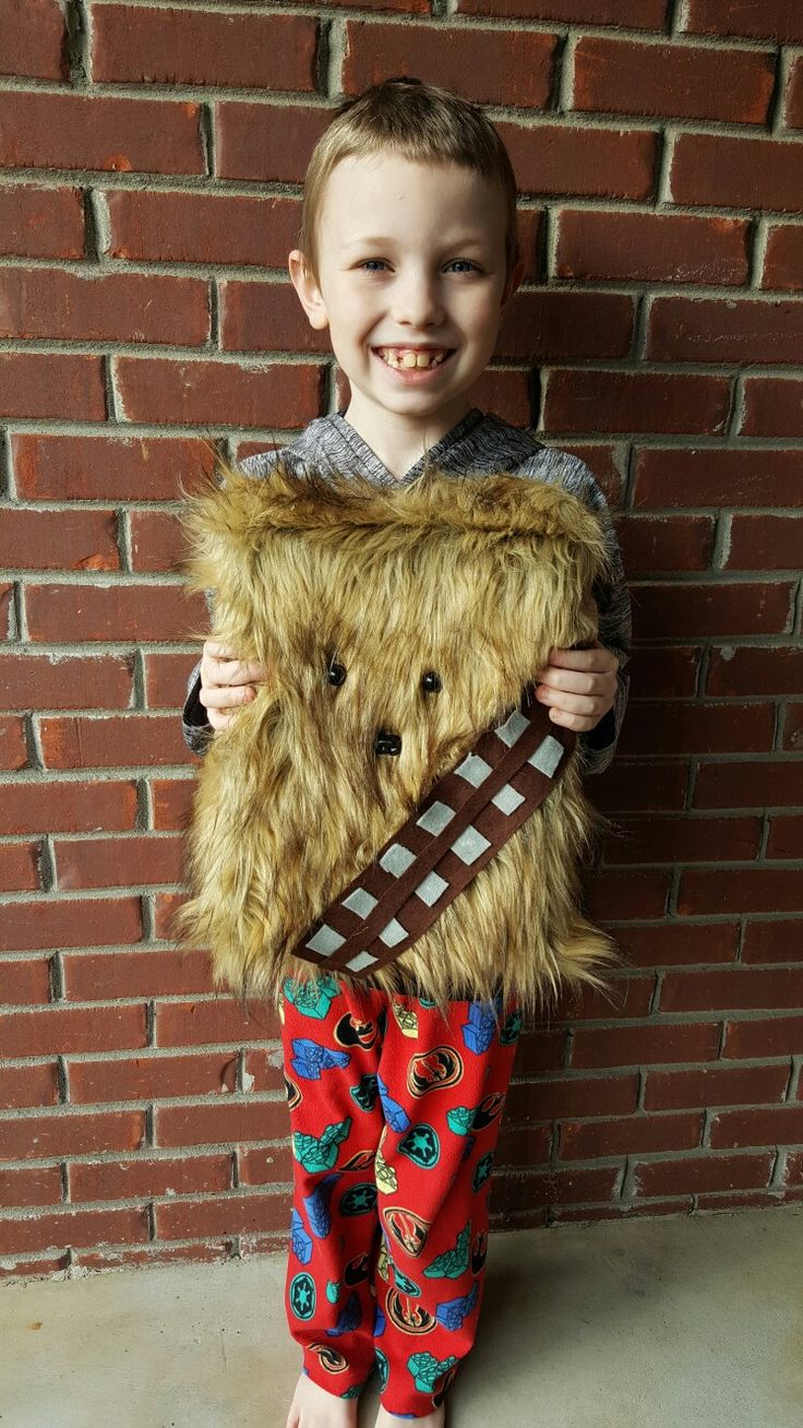 My son and I made a Star Wars Chewbacca Valentines Day Box for his classroom Valentines Day party this year. We used a cereal box, fake fur from Hobby Lobby, felt for the belt, and Animal eyes/nose! Everything was easily glued on with tacky glue! It was super easy and looks so cool!