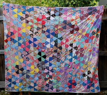 Vintage quilt found at a thrift store, blogged at Bella Dia.  We're intrigued by the pattern (many Y seams)