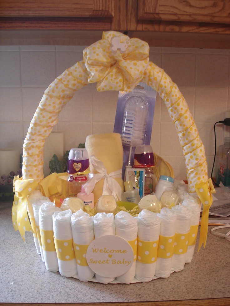 Via Etsy. Each Diaper is individualy wrapped with ribbon and glued in place. This basket is filled with baby goodies, including homemade washcloth lollipops. I think the handle is a wrapped pool noodle! ADORBS!