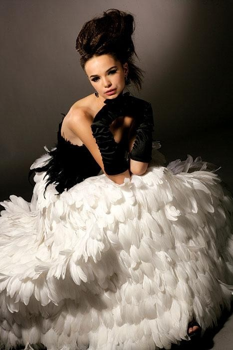 I can't help but think of the Katnis's mockingjay dress. B-E-A-U-tiful! @Jessica Mitchell