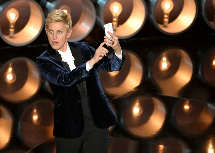 """Host Ellen DeGeneres takes a selfie showing all the \""""beautiful\"""" people she's surrounded by."""
