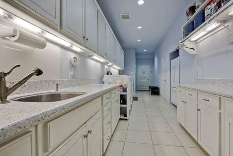 This is a LAUNDRY room (32x7ft.)!!! I could so use this for my tornado room with the kids! It even has room for a full refrigerator! from Realtor.com®
