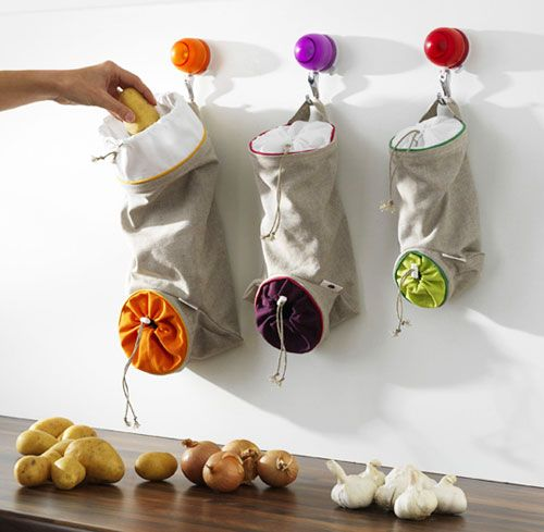 Hanging vegetable keep sacks from Orka, however, and now I am rather smitten. These bags have all sorts of great little features. These keep sacks come in three sizes, and they are designed to be hung on a wall or in a pantry. Each sack is made of cotton and linen, and they are machine washable. They each have a drawstring opening at the top, to put vegetables in, and another at the bottom, to let you take them out. The potato bag holds 8 pounds, the onion bag 4 pounds and the garlic bag 2…