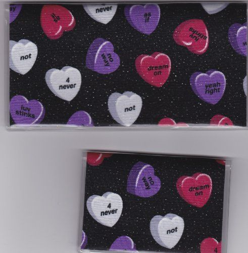 "Not So Nice Candy Hearts on Black Checkbook Cover Set by Tickled Pink Boutique. $9.50. Fun and functional for every day use without paying a designer price for a designer name!  The sturdy clear PLASTIC 12 gauge lightweight VINYL COVER encases a fabric bonded design. Measuring 6 1/4"" x 3 1/4"",  the checkbook cover fits all standard bank checkbooks and banking registers.  All checkbook covers come with a register flap and a duplicate check flap just like the bank.   ..."