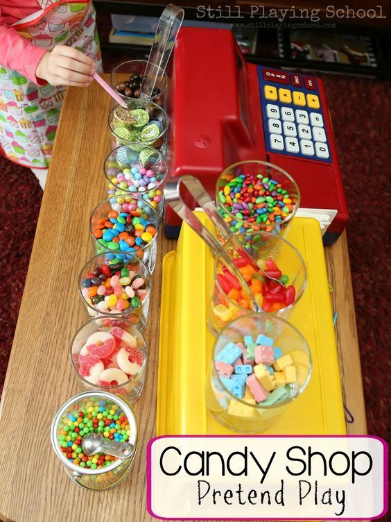 Kid experience math, writing, and fine motor skills through this pretend play candy shop dramatic center!
