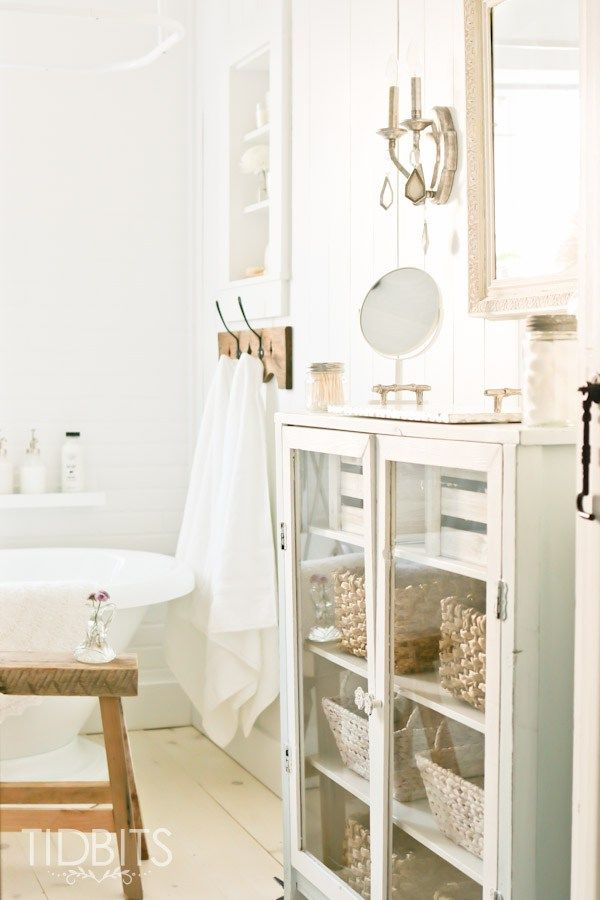 Cottage Bathroom makeover by TIDBITS. A dull and dingy bathroom gets a complete gut job and charming makeover.