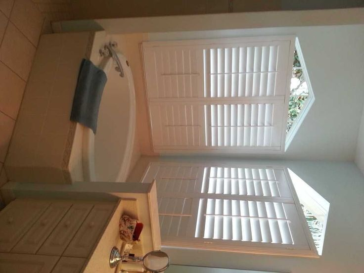 Plantation Shutters On Corner Bathroom Windows. This Home Owner Opted To  Keep The Triangle Portion