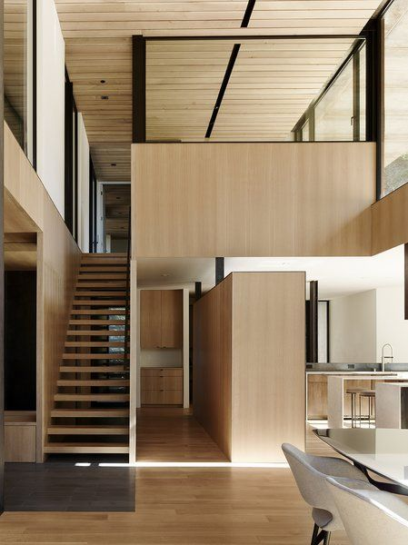 The ceiling is untreated white oak. Tagged: Staircase and Wood Tread.  Photo 6 of 14 in Nature Drove the Design of This Sculptural, Cor-Ten Steel House in Northern California