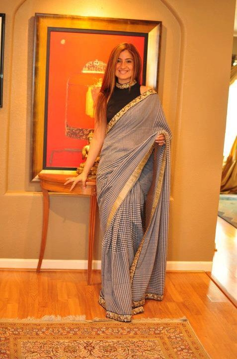 i love this kind of sarees... unlikely for a saree print or fabric... want!