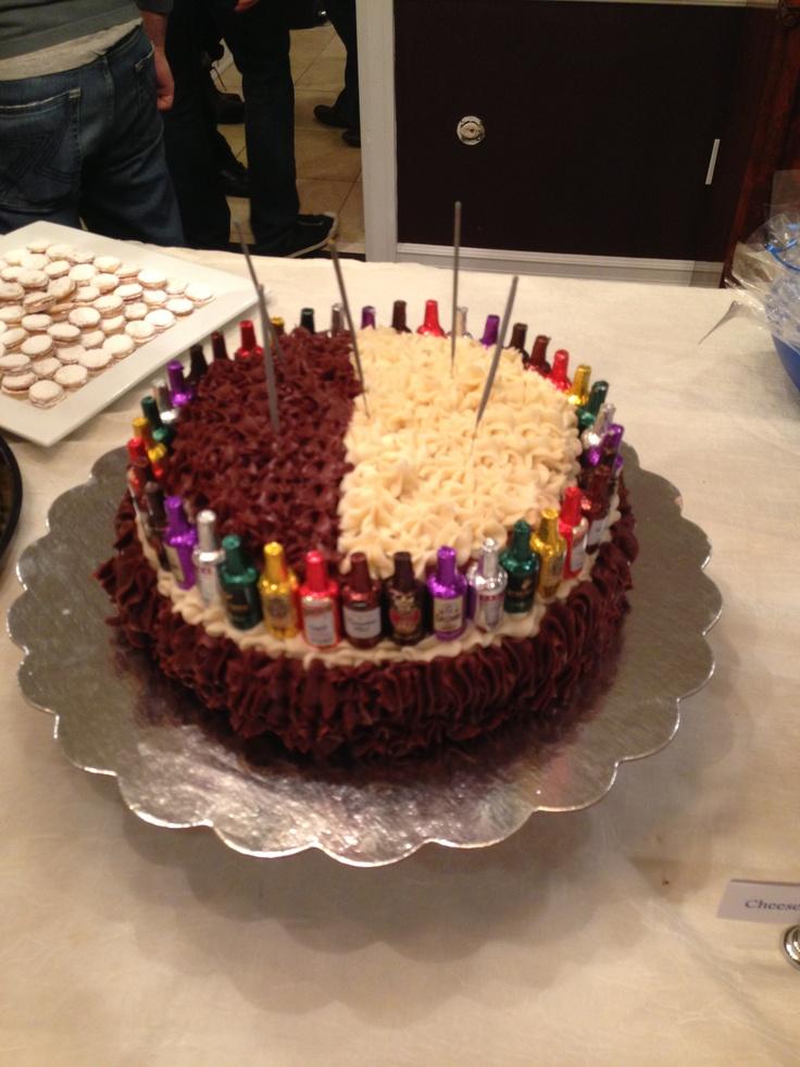 Birthday Cake For My Brother In Law Decorated With Mini Chocolate Liquor Bottles And Sparklers On Top Diy Food Gifts Candy Gifts Diy Food Gifts