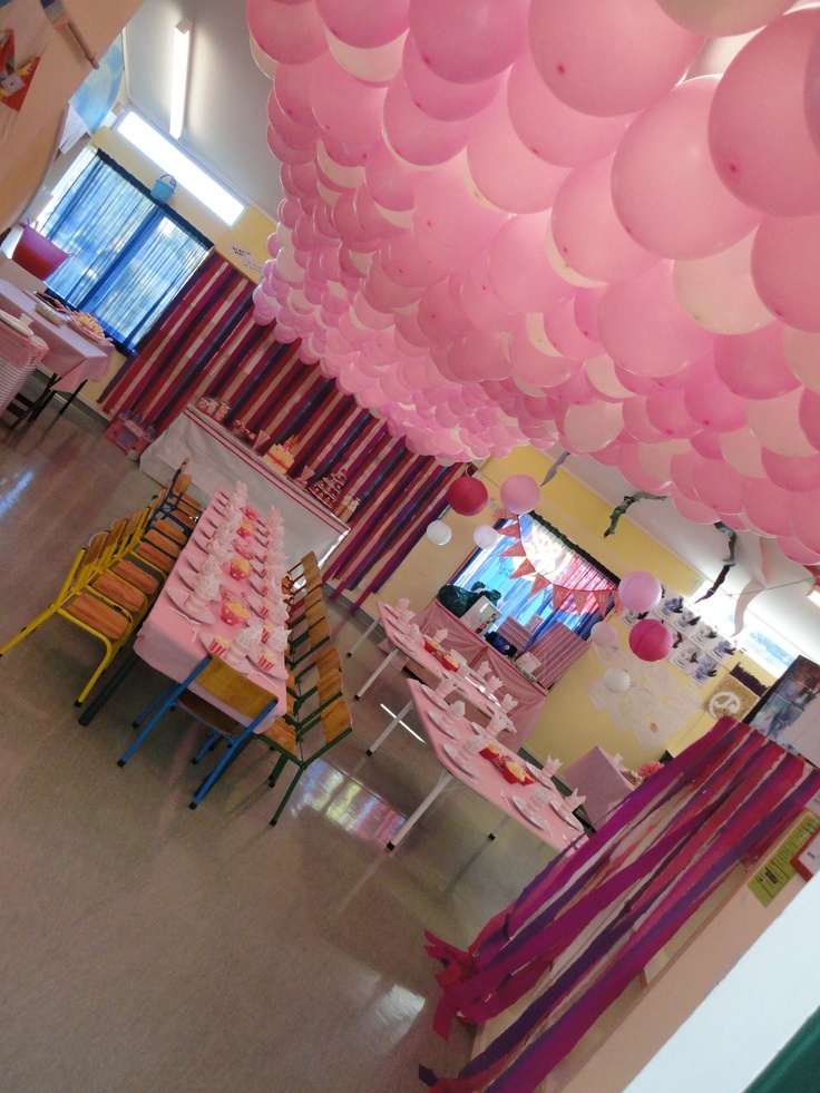 Balloons give any birthday a festive feel, group them up and cover the roof using string, paper clips to hook the balloons on to the string, and heaps of balloons