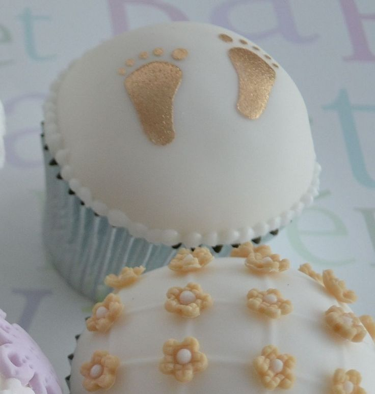 White and gold baby shower cupcakes party decor ideas for Baby feet decoration