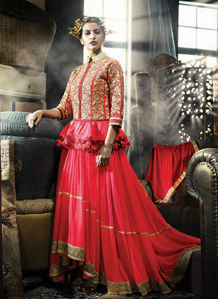 Featuring red peplum style indo western gown intricately designed with heavy floral embroidery. It is paired with matching chiffon duppata. This suit can be stitched upto size 44. For stitching enquiries, please email us at customercare@hunardesigns.com  |…