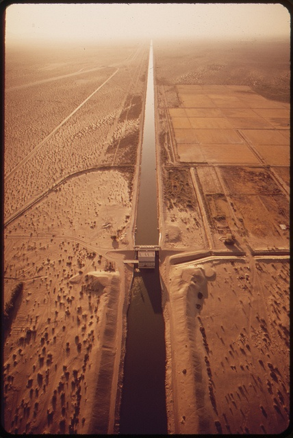 All-American Canal feeding thirsty Imperial Valley with water from the Colorado River. Mexico on left, May 1972 by The U.S. National Archives, via Flickr