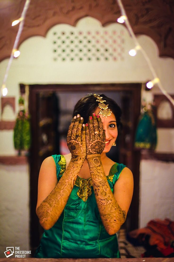 Gotta love the shy Indian bride behind  her Mehendi clad hands. Too cute!