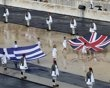 The British and Greek flags are carried into the marble Panathenaic stadium during an Olympic Flame ceremony in Athens May 17, 2012.