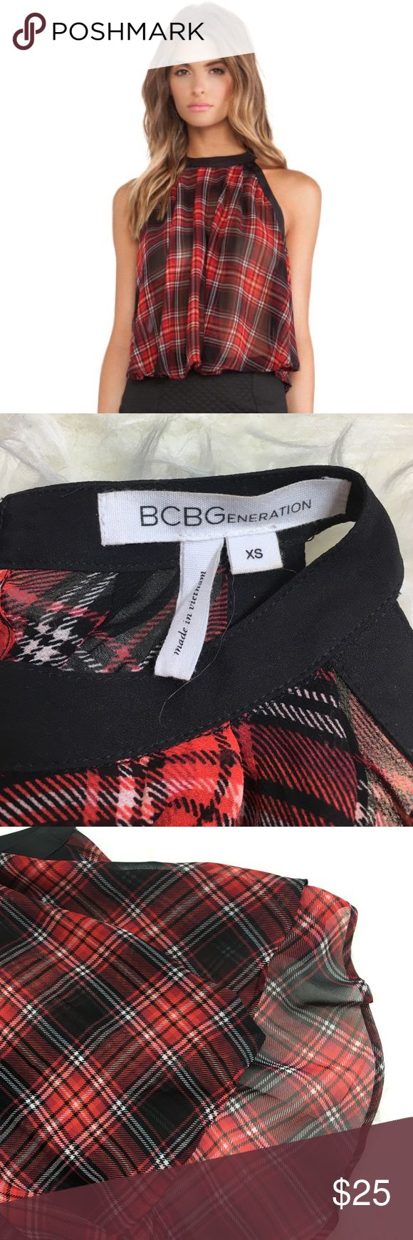 Top Red black and white plaid high neck tank blouse with flowy longer hem in back bottom. Worn once. No signs of wear and tear or stains. BCBGeneration Tops