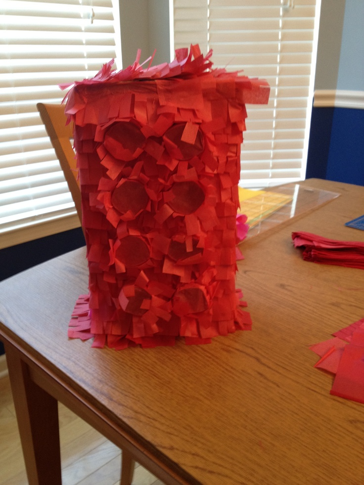Lego piñata - basic box shape, 1/3 TP roll glued to circles of cardstock, then glued/taped to shape. Covered with tissue. Got construction ideas from this pin:  http://pinterest.com/pin/188799409349555464/