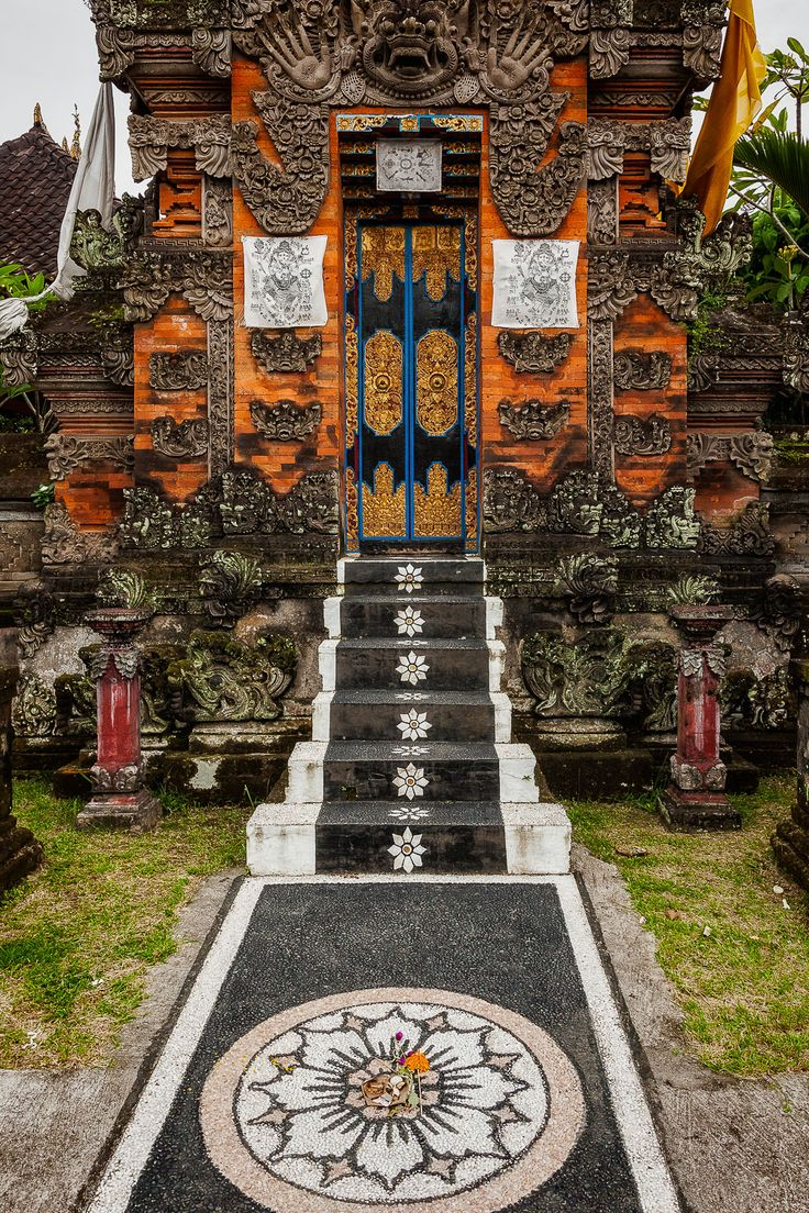 An ornately decorated pathway leads to a beautiful entrance to a Hindu Shrine in Bali, Indonesia.