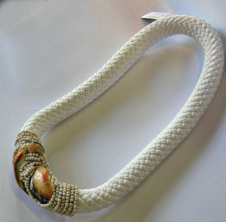 Shells and beads sewn onto thick white rope
