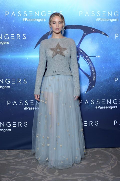 November 29, 2016 Because Jennifer Lawrence could make anything look effortlessly chic, she showed up to the Passengers photo call in Paris in our snuggly red carpet ideal: a Christian Dior sweater and sheer skirt combo. We're taking notes for our winter going-out getups.